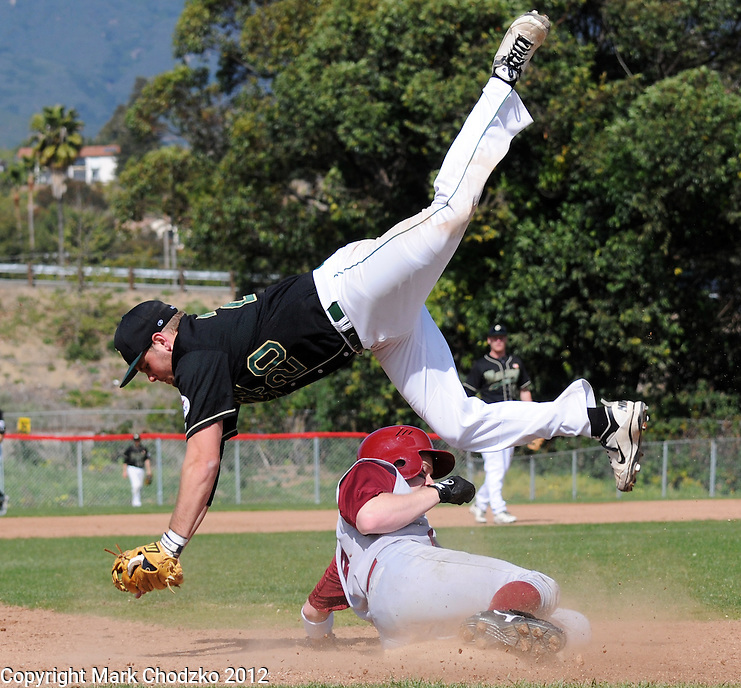 Stanford runner slides under the tag of Cal Poly San Luis Obispo third baseman.