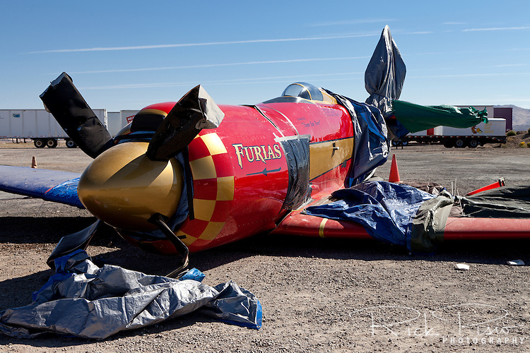 Unlimited Air Racer Furias sits on the ground after a landing gear collapse. Furias is a modified Hawker Sea Fury.