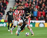 Stoke's Erik Pieters tussles with Manchester United's Paul Pogba during the premier league match at the Britannia Stadium, Stoke on Trent. Picture date 9th September 2017. Picture credit should read: David Klein/Sportimage