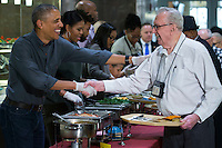 United States President Barack Obama, with First Lady Michelle Obama, shakes hands while serving Thanksgiving dinner to residents at the Armed Forces Retirement Home in Washington, DC, USA, 23 November 2016.<br /> Credit: Shawn Thew / Pool via CNP /MediaPunch