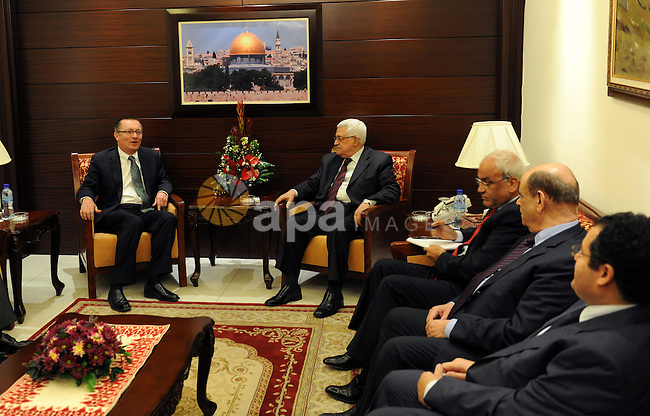 Palestinian President Mahmoud Abbas sits near the U.S. Assistant Secretary of State for Near East Affairs Jeffrey Feltman before their meeting in the West Bank city of Ramallah December 5, 2011. Photo by Thaer Ganaim