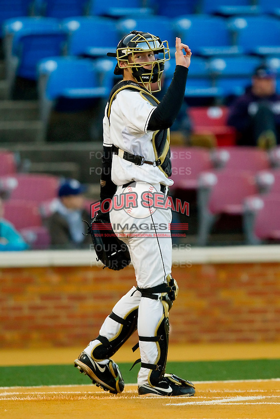 Catcher Brett Armour #6 of the Wake Forest Demon Deacons lets the defense know there are two outs against the North Carolina Tar Heels at Gene Hooks Field on March 11, 2011 in Winston-Salem, North Carolina.  Photo by Brian Westerholt / Four Seam Images
