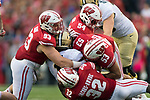 Wisconsin Badgers teammates Garrett Rand (93), Chris Orr (54), T.J. Edwards (53) and Leon Jacobs-Nwude (32) tackle Purdue Boilermakers running back D.J. Knox (1) during an NCAA College Football Big Ten Conference game Saturday, October 14, 2017, in Madison, Wis. The Badgers won 17-9. (Photo by David Stluka)