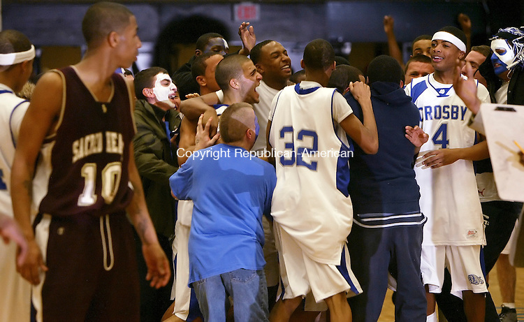 WATERBURY, CT, 02/04/08- 020409BZ20- Crosby players and fans celebrate their 80-77 over Sacred Heart as Josh Turner (10) looks on while walking off the court Wednesday night.  Turner missed the final shot attempt to tie the game.<br /> Jamison C. Bazinet Republican-American