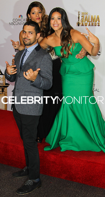 PASADENA, CA, USA - OCTOBER 10: Wilmer Valderrama, Andrea Navedo, Gina Rodriguez pose in the press room at the 2014 NCLR ALMA Awards held at the Pasadena Civic Auditorium on October 10, 2014 in Pasadena, California, United States. (Photo by Celebrity Monitor)
