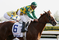 Dullahan and Kent Desormeaux win the 88th running of the Toyota Blugrass Stakes.  April 14, 2012.