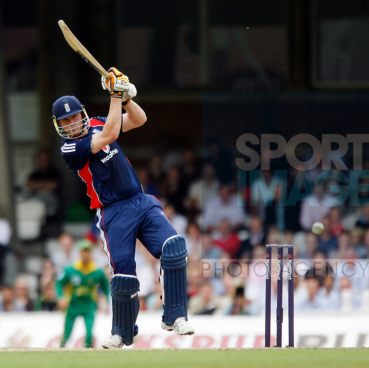 England's Andrew Flintoff hits a four on his way to 78