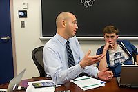 Assistant Professor of Geology David Szymanski of Bentley University's Department of Natural and Applied Science meets with students after the full NASE402 Science in Environmental Policy course in Waltham, Massachusetts, USA.  The class involves an optional extra section that includes a trip to Washington, D.C., for these students to meet with policy makers and discuss the role of science in making government policy.