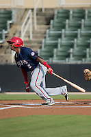 Osvaldo Abreu (10) of the Hagerstown Suns follows through on his swing against the Kannapolis Intimidators at CMC-Northeast Stadium on July 19, 2015 in Kannapolis, North Carolina.  The Suns defeated the Intimidators 9-4.  (Brian Westerholt/Four Seam Images)