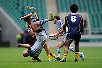 Igor Klyuchnikov of VVA Saracens Moscow is spear tackled by Andrew Smith of the Brumbies during the World Club 7s at Twickenham on Sunday 18th August 2013 (Photo by Rob Munro)