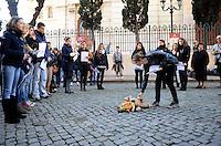 Roma 12 Gennaio 2011..Via Catalana,.Memorie d'Inciampo a Roma.Sampietrini rivestiti d'una placca d'ottone lucente incastonati a terra di fronte ai portoni dei deportati ad Auschwitz. L'idea è dell'artista tedesco Gunther Demnig nell'ambito del progetto «Memorie d'Inciampo a Roma» che prevede in vari Municipi il posizionamento di pietre , ciascuna dedicata ad un deportato per ragioni razziali, politiche e militari, di fronte alle loro abitazioni..Nella foto il lavoro del liceo visconti in memoria dei bambini e giovani deportati, foto ,nomi e oggetti per ricordarli..Olocaust memorial plaques to victims in Rome.