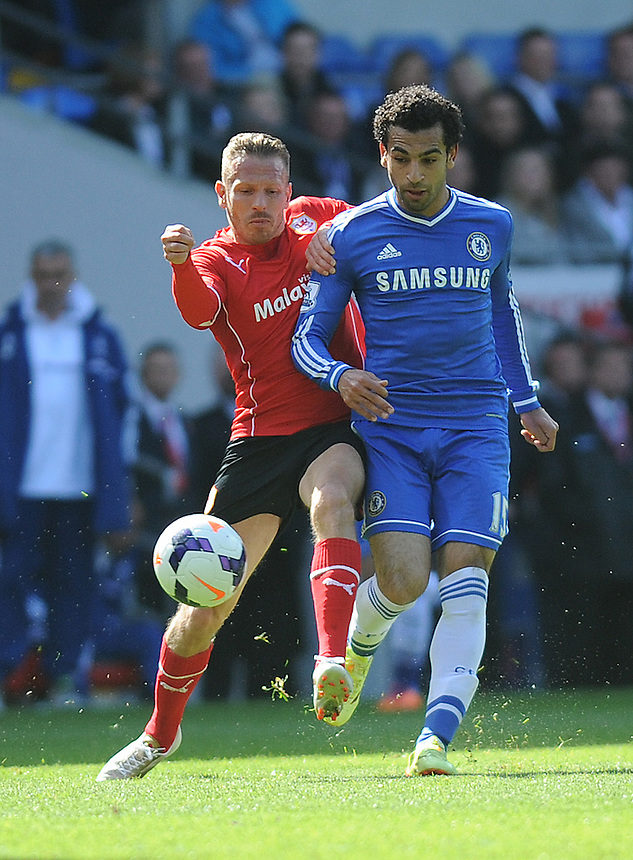 Cardiff City's Craig Bellamy vies for possession with Chelsea's Mohamed Salah<br /> <br /> Photographer Ashley Crowden/CameraSport<br /> <br /> Football - Barclays Premiership - Cardiff City v Chelsea - Sunday 11th May 2014 - Cardifff City Stadium - Cardiff<br /> <br /> &copy; CameraSport - 43 Linden Ave. Countesthorpe. Leicester. England. LE8 5PG - Tel: +44 (0) 116 277 4147 - admin@camerasport.com - www.camerasport.com
