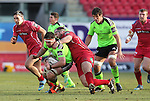 Scarlets prop Phil John tackles Munster lock Billy Holland.<br /> Guiness Pro12<br /> Scarlets v Munster<br /> 21.02.15<br /> ©Steve Pope -SPORTINGWALES