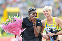Photo: Tony Oudot/Richard Lane Photography..Aviva London Grand Prix. 24/07/2009. .women's 400m B Final. .Second place Donna Fraser shares a joke with winner Vicky Barr.