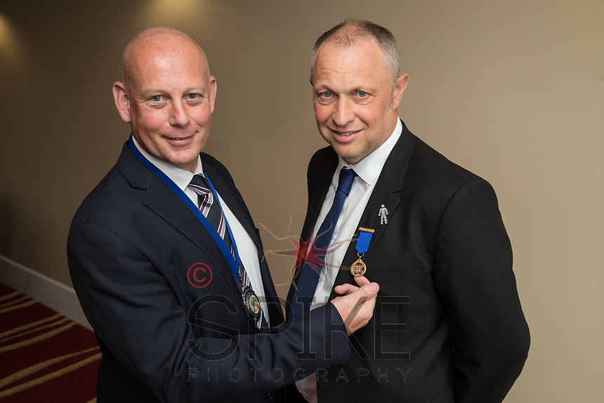 Outgoing Nottingham City Business Club president Mark Deakin (right) receives a Past President's Jewel from new president Ian Roberts