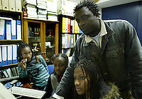 The youngs girls looks during information classroom of the Ermelindo Quaresma teacher at Moinho de Vento on street of Cova da Moura, a rundown suburb of Lisbon 23 January 2008. Cova da Moura is home to a large African population.