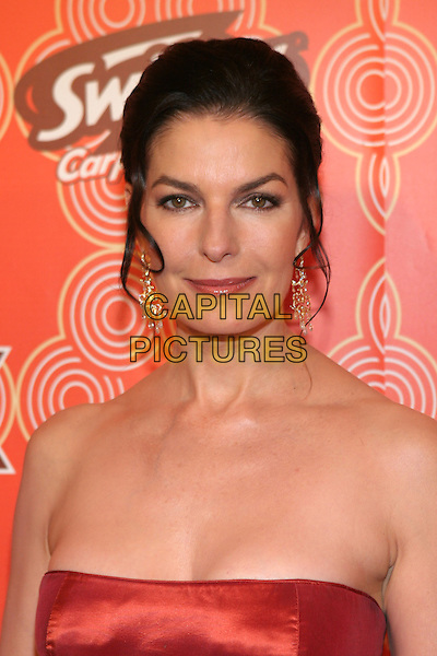 SELA WARD.OX Fall Casino Party held at the Cabana Club, Hollywood, California..October 24th, 2005.Photo Credit: Zach Lipp/AdMedia/Capital Pictures.Ref: ZL/ADM.headshot portrait strapless dangling earrings.www.capitalpictures.com.sales@capitalpictures.com.© Capital Pictures.