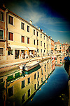 Houses reflected on a canal, Dorsoduro, Venice, Italy.