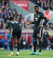 Paul Pogba of Man Utd chats to Marcus Rashford of Man Utd during the Premier League match between Stoke City and Manchester United at the Britannia Stadium, Stoke-on-Trent, England on 9 September 2017. Photo by Andy Rowland.