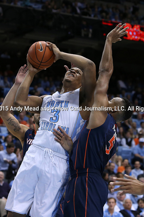02 February 2015: North Carolina's Kennedy Meeks (3) shoots over Virginia's Darion Atkins (5). The University of North Carolina Tar Heels played the University of Virginia Cavaliers in an NCAA Division I Men's basketball game at the Dean E. Smith Center in Chapel Hill, North Carolina. Virginia won the game 75-64.