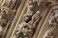The stoning of Jeremiah, on one of the left-hand archivolts of the tympanum of the South portal or St Honore portal on the South transept of the Basilique Cathedrale Notre-Dame d'Amiens or Cathedral Basilica of Our Lady of Amiens, built 1220-70 in Gothic style, Amiens, Picardy, France. St Honore or Honoratus was the 7th bishop of Amiens who lived in the 6th century AD. Amiens Cathedral was listed as a UNESCO World Heritage Site in 1981. Picture by Manuel Cohen