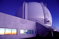 A beautiful sunset is reflected on the glass windows of Keck Observatory on the Big Island of Hawaii.