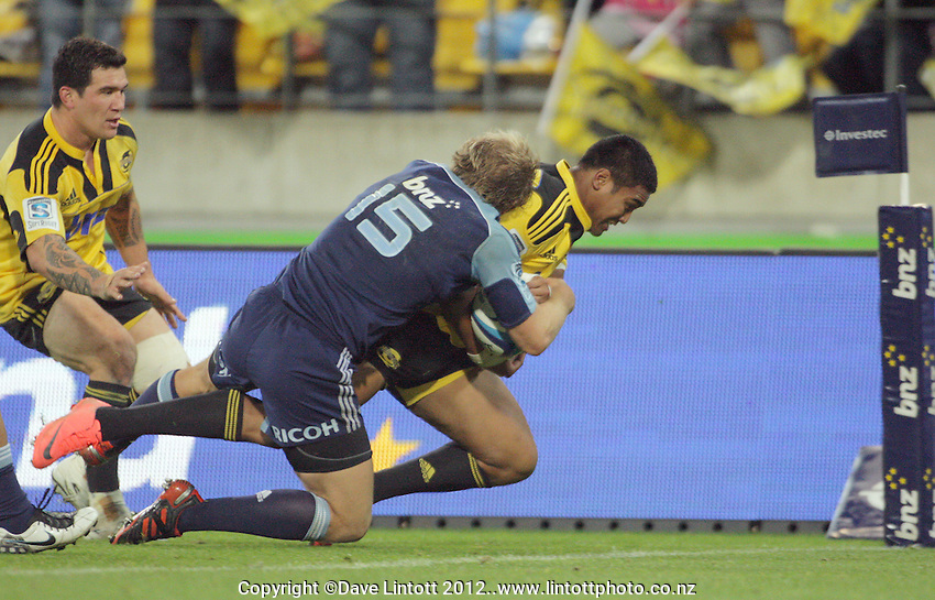 Julian Savea scores in the corner during the Super 15 rugby match between the Hurricanes and Blues at Westpac Stadium, Wellington, New Zealand on Friday, 4 May 2012. Photo: Dave Lintott / lintottphoto.co.nz
