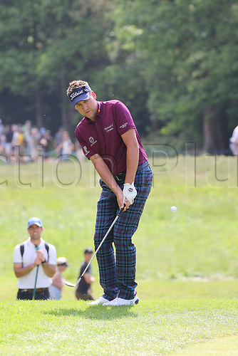 May 25th 2017, Virginia Water, Wentworth, Surrey, England; BMW PGA Championship golf, day 1; Ian Poulter plays a chip shot on the par 3 14th