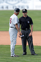 Mahoning Valley Scrappers manager Ted Kubiak (36) argues a call with field umpire George Reidel during a game against the Batavia Muckdogs on September 1, 2013 at Dwyer Stadium in Batavia, New York.  Mahoning Valley defeated Batavia 6-0 behind a no-hitter.  (Mike Janes/Four Seam Images)