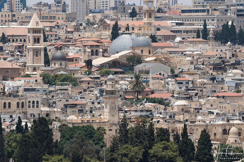The Muslim and Christian Quarters of the Old City of Jerusalem.  The Bab al Silsila minaret is in the center foreground with the grey dome of the Sisters of Zion Convent and bell tower of the Lutheran Church of the Redeemer behind at left.  At right are the two domes of the Church of the Holy Sepulchre.   The Old City of Jerusalem and its Walls is a UNESCO World Heritage Site.  The large white building at top left is the King Solomon Hotel.