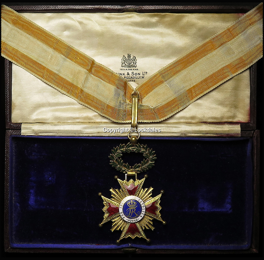 BNPS.co.uk (01202 558833)<br /> Pic: Lockdales/BNPS<br /> <br /> Neck Badge of the Commander of the Order of Isabel la Catolica.<br /> <br /> The little-known tale of the original British spy codenamed 'M', a role made famous by the James Bond films, has been revealed after his service medals emerged for sale.<br /> <br /> Former police detective William Melville used the legendary cryptonym while reporting back to the War Office in the early 1900s before becoming the first chief of the British Secret Service Bureau.<br /> <br /> Melville, who hunted Jack the Ripper before becoming a spy, would sign top secret documents with the first letter of his surname - 'M' - while working for the forerunners of intelligence agencies MI5 and MI6.<br /> <br /> The memorabilia will go under the hammer with an estimate of £1,200 on November 19.