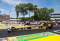 Jun. 1, 2014; Englishtown, NJ, USA; NHRA top fuel driver Tony Schumacher (near lane) races alongside Doug Kalitta  during the Summernationals at Raceway Park. Mandatory Credit: Mark J. Rebilas-
