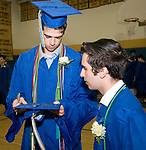 WINSTED, CT-062317JS05-  Gilbert graduate Ryan Sholtis, left, signs the cap of fellow graduate Michael Katz, prior to graduation ceremonies Friday at the Gilbert School in Winsted. <br /> Jim Shannon Republican-American