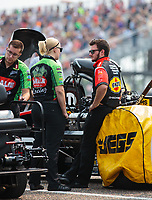 Aug 18, 2018; Brainerd, MN, USA; Crew members for NHRA top fuel driver Leah Pritchett and Terry McMillen during qualifying for the Lucas Oil Nationals at Brainerd International Raceway. Mandatory Credit: Mark J. Rebilas-USA TODAY Sports