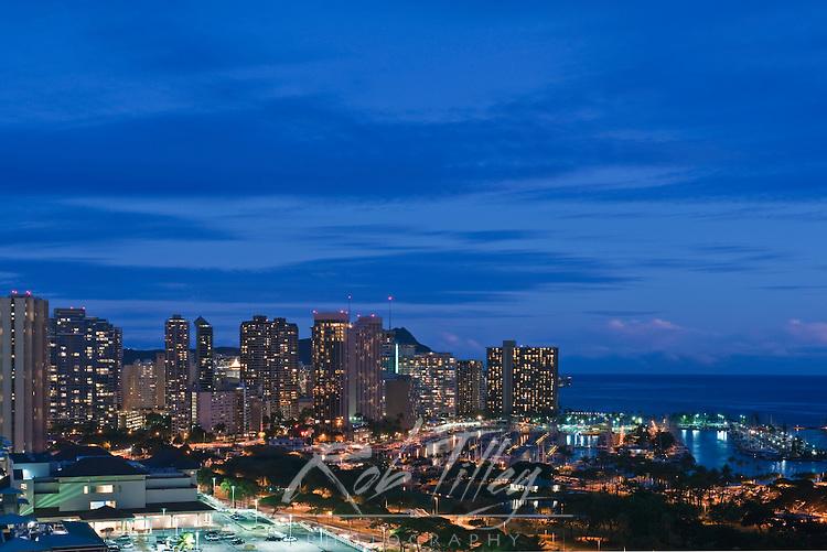 USA, HI, Honolulu, Waikiki Skyline at Twilight