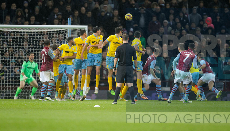 Leandro Bacuna of Aston Villa fires a free kick on target to force a save from Julian Speroni - Barclays Premiership Football - Aston Villa v Crystal Palace - Villa Park  Birmingham - Season 14/15 - 01/01/2015 <br /> Photo: Malcolm Couzens/Sportimage