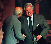 "United States Senator Edward M. ""Ted"" Kennedy (Democrat of Massachusetts) is congratulated by Norman Lear after he received the People for the American Way's Defenders of Democracy Award in Washington, D.C. on May 18, 1998..Credit: Ron Sachs / CNP"