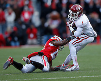 Indiana Hoosiers wide receiver Shane Wynn (1) slips a tackle by Ohio State Buckeyes cornerback Doran Grant (12) during Saturday's NCAA Division I football game at Ohio Stadium in Columbus on November 23, 2013. (Barbara J. Perenic/The Columbus Dispatch)