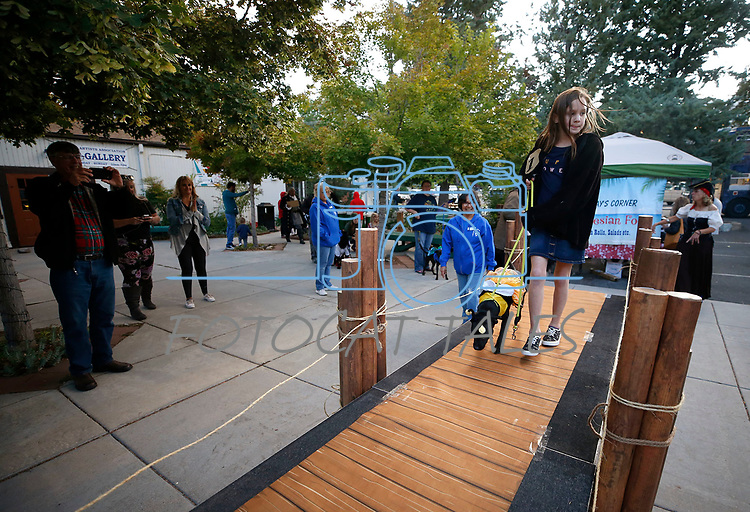 Zoe New, 9, leads Stitch, 1, over the catwalk  during the Scallywaggers Pirate Pup Parade at the Brewery Arts Center, in Carson City, Nev., on Wednesday, Sept. 18, 2019.<br /> Photo by Cathleen Allison/Nevada Momentum