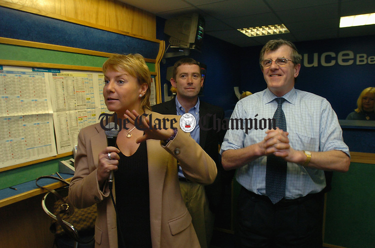 "Racing commentator Tracy Piggott and jockey Conor O Dwyer with Bruce Byrne at the official opening of his latest betting shop ""Bruce Betting"" in the market, Ennis. Photograph by John Kelly."