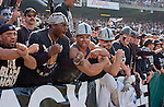 "Raider fans in the ""Black Hole"" use dummy with number 55 on it to taunt San Diego Chargers linebacker Junior Seau (55) on Sunday, November 18, 2001, in Oakland, California. The Raiders defeated the Chargers 34-24."