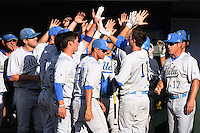 Trevor Brown #11 of the UCLA Bruins is greeted by his teammates against the TCU Horned Frogs at the Los Angeles super regionals at Jackie Robinson Stadium on June 9, 2012 in Los Angeles,California. UCLA defeated TCU 4-1.(Larry Goren/Four Seam Images)