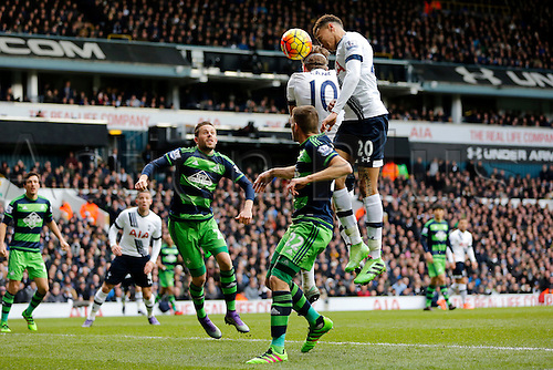 28.02.2016. White Hart Lane, London, England. Barclays Premier League. Tottenham Hotspur versus Swansea City. Dele Alli of Tottenham Hotspur heads towards goal over Harry Kane watched by Sigurdsson