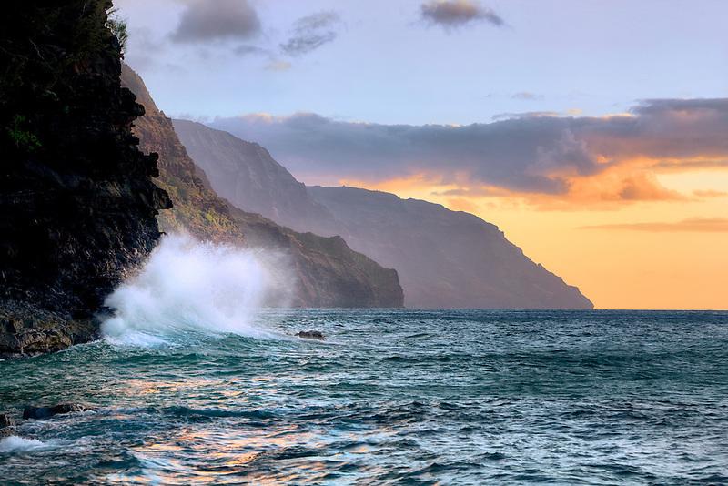 Wave on Napali Coast at sunset. Kauai, Hawaii