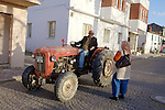 Man On Tractor Talking to Woman