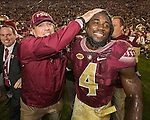 Florida State head coach Jimbo Fisher and running back Dalvin Cook celebrate defeating Florida 31-13 in an NCAA college football game in Tallahassee, Fla., Saturday, Nov. 26, 2016. (AP Photo/Mark Wallheiser)