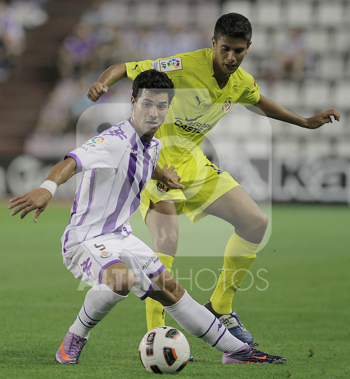 Real Valladolid's Javi Guerra (f) and Villareal B's Carlos Tomas during Spanish 2th Division match.August 27,2010. (ALTERPHOTOS/Acero)