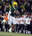 Oregon quarterback Jeremiah Masoli heads upfield during the Civil War at Autzen Stadium..Photo by Jaime Valdez