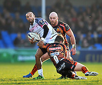 Eli Walker of the Ospreys is double-tackled. European Rugby Champions Cup match, between Exeter Chiefs and the Ospreys on January 24, 2016 at Sandy Park in Exeter, England. Photo by: Patrick Khachfe / JMP