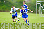 St Mary's Sean Cournane gets by Castleisland Desmond's Niall Mitchels in the division 3 clash at Castleisland on Saturday.